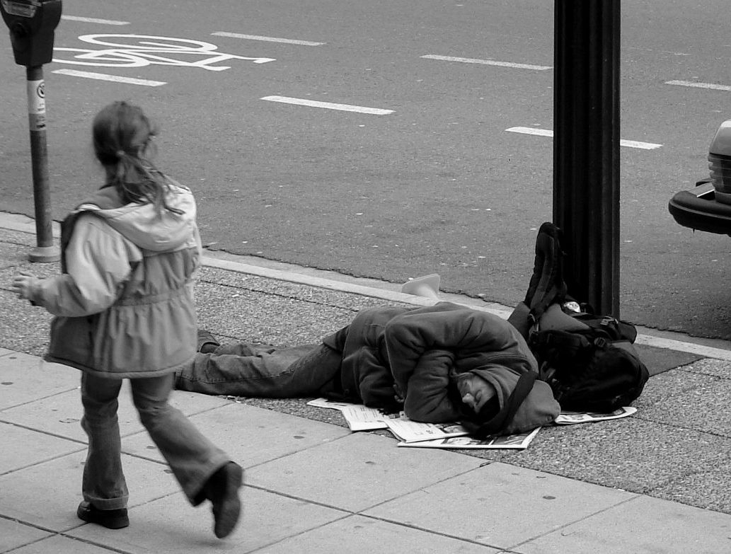 Man_sleeping_on_Canadian_sidewalk